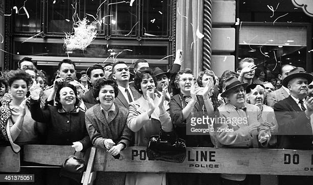 A crowd of supporters line the street and applauds as Senator John F Kennedy passes by during a visit to New York on his presidential campaign 1960