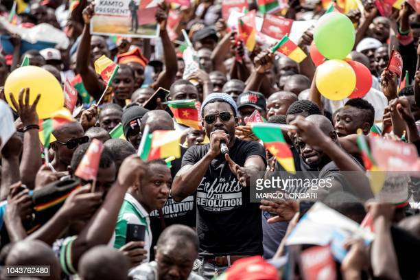 A crowd of supporters of the leader of the Cameroonian opposition party Movement for the Rebirth of Cameroon greets the arrival of popular...