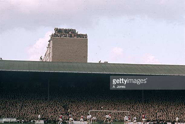 A crowd of supporters on the roof of a tower block overlooking the fourth round FA Cup match between West Ham United and Hereford Nonleague Hereford...