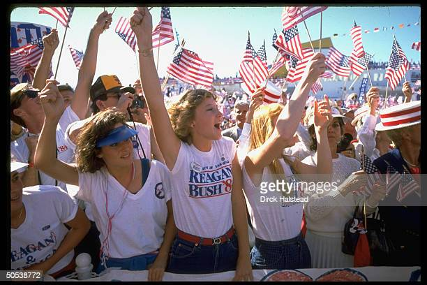 Crowd of supporters waving American flags at rally to support the reelection campaign ticket of President Ronald Reagan and Vice President George Bush