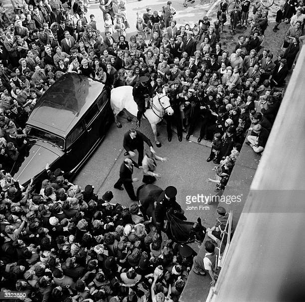 A crowd of teenage fans celebrating the return to London of the American crooner idol of the fifties Johnnie Ray who had hits with 'Just Walking In...