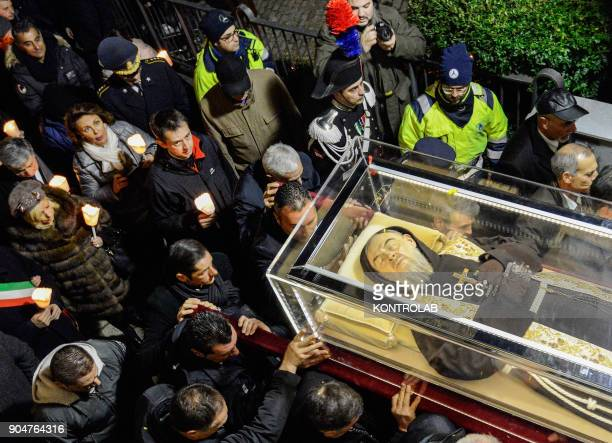 PIETRELCINA CAMPANIA ITALY A crowd of the faithful follows the relics of Padre Pio during the procession through the streets of Petrelcina birthplace...