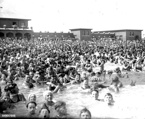 A crowd of thousands is pictured at Carson Beach in South Boston circa August 1932