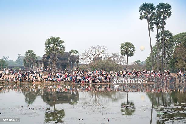 Crowd of Tourists photographing at Sunrise, Angkor Wat, Cambodia