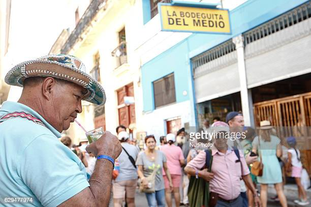 A crowd of tourists seen outside Bodeguita del Medio a typical restaurantbar of Havana and a famous tourist destination because of the personalities...