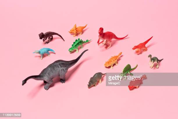 a crowd of toy dinosaurs - hoarding concept stock pictures, royalty-free photos & images