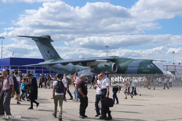 Crowd of visitors at the tarmac of Le Bourget Airport during Paris Air Show 2019 and the Brazilian Air Force Embraer KC-390 renamed after Boeing and...