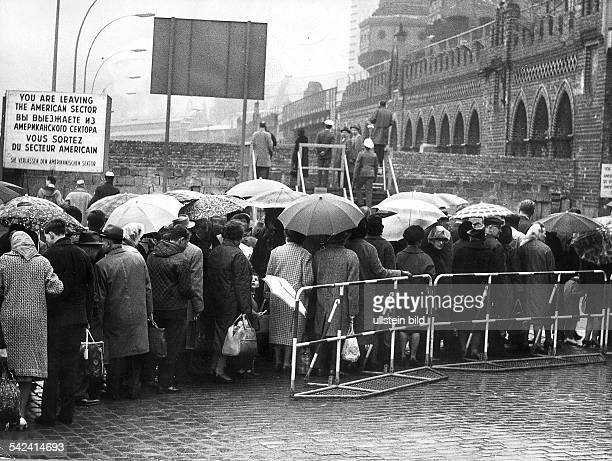 Crowd of West Berliners waiting at the border crossing at Oberbaumbrücke -