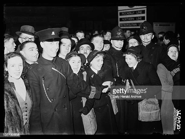 Crowd of Wrens 1941 A photograph of police holding back a crowd of Women's Royal Naval Servicewomen at a London station taken by Calcraft for the...