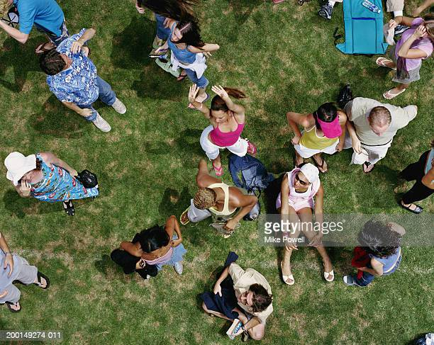 crowd of young adults at outdoor event, elevated view - festival goer stock pictures, royalty-free photos & images