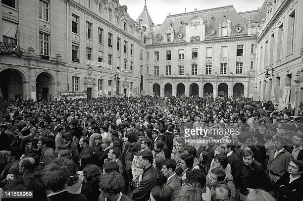 A crowd of young people and adults in the inner courtyard of the Sorbonne which has been occupied by students and teachers since May 13 They are...