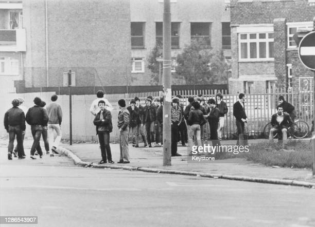 Crowd of youths standing on a street corner before rioting started in the Toxteth area of Liverpool, England, July 1981.