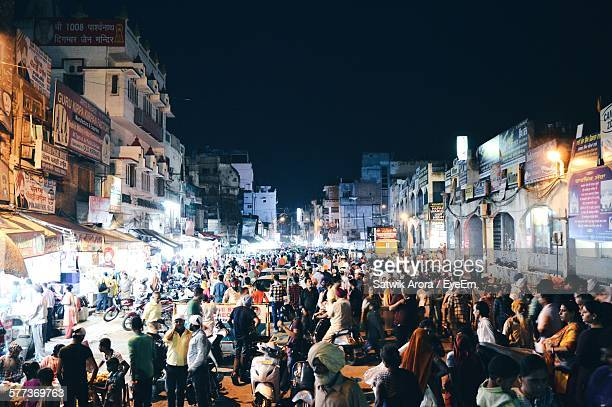 crowd on city street against clear sky at night - amritsar stock pictures, royalty-free photos & images