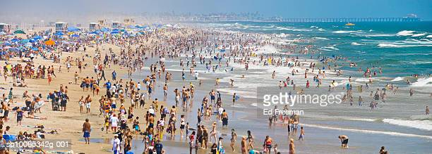 crowd on huntington beach - orange county crowded beaches stock pictures, royalty-free photos & images
