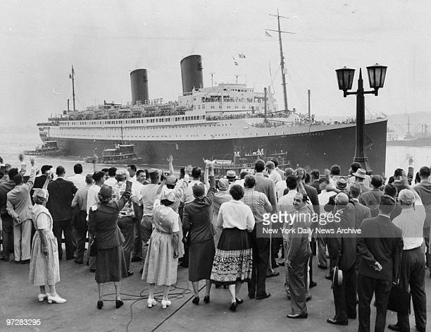 Crowd on Pier 88 wave as the Ile de France comes in with survivors from the Andrea Doria and Stockholm liners collision