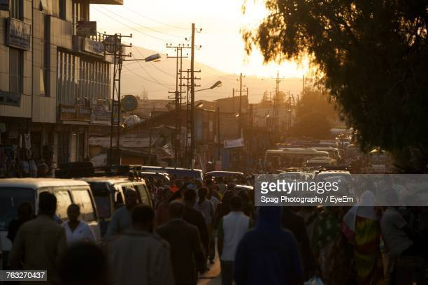 Crowd On Road In City During Sunset