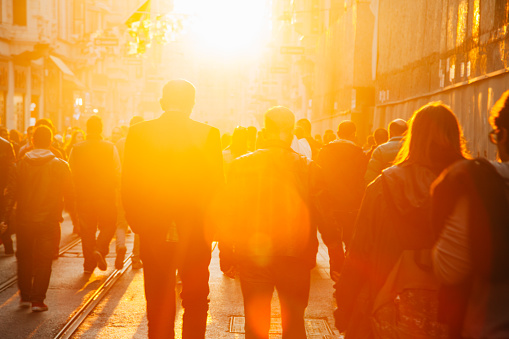 Crowd on street in bright lens flare - gettyimageskorea