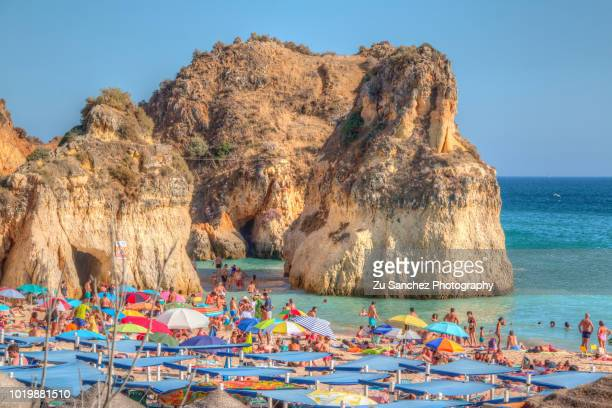 crowd on the algarve coast. - alvor stock pictures, royalty-free photos & images