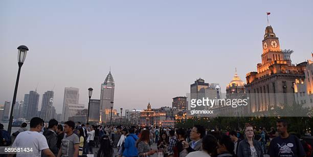 Crowd on the Bund at dusk, Shanghai, China
