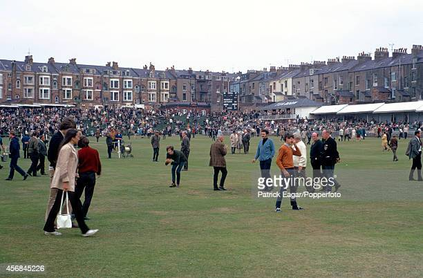 Crowd on the field during an interval, T N Pearce's XI v Rest of the World XI at Scarborough 1970.