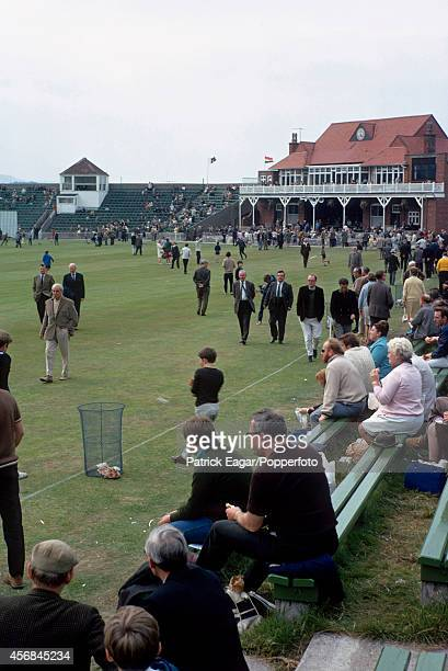 Crowd on the field during the tea interval, T N Pearce's XI v Rest of the World XI at Scarborough 1970.