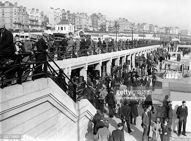 Crowd on the promenade at Brighton 1931 A Crowd on the promenade at Brighton Sussex 11 April 1931 Photograph by Harold Tomlin