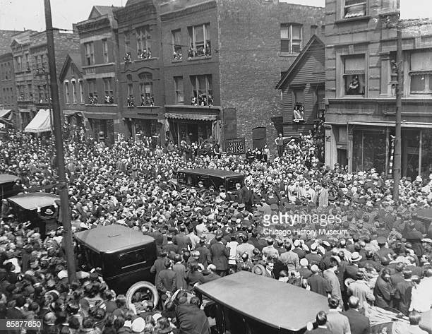 Crowd on the street for the funeral of assistant prosecutor William H McSwiggin Chicago 1926 Capone was immediately suspected of having killed the...