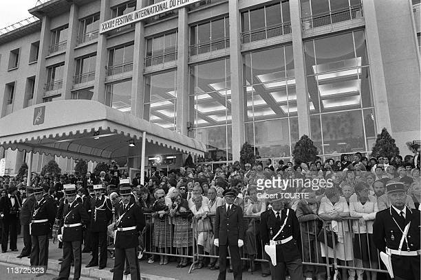 A crowd outside the entrance to the old Palais De Festival at the Cannes Film Festival during 1979 in CannesFrance
