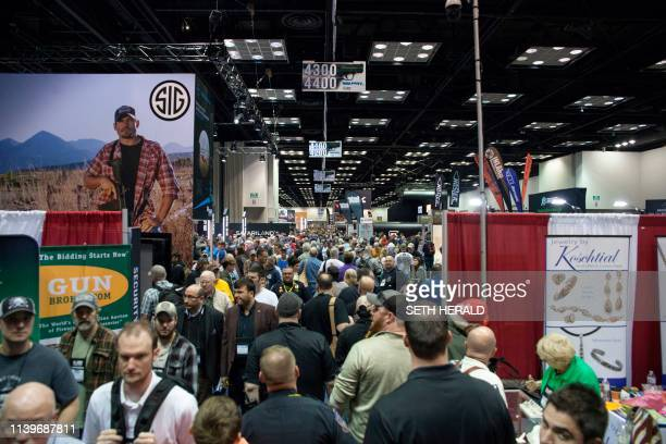 A crowd packs the Indiana Convention Center during the National Rifle Association 2019 Annual Meetings on Saturday April 272019 in Indianapolis...