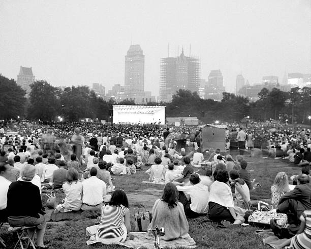 Crowd packs the Sheep Meadow area of Central Park to listen