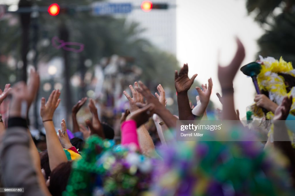 Crowd partying and raising hands during festival : Stock Photo