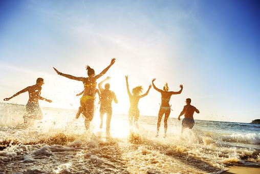 Crowd people friends sunset beach holidays 642987348