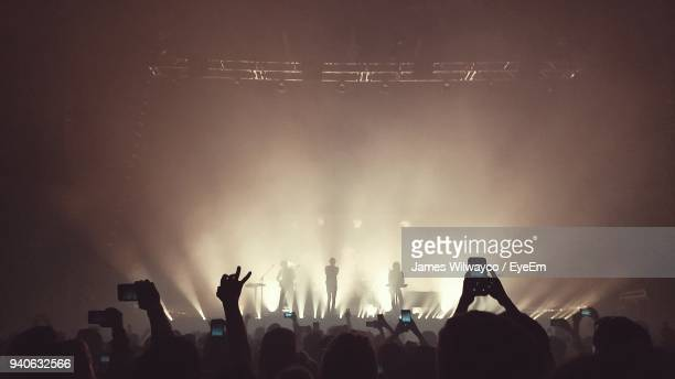crowd photographing at music concert - concert stock pictures, royalty-free photos & images