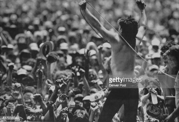 Crowd Pleaser--Bono of U2 stands on a stage barrier during U2's performance at the US Festival near San Bernardino, Calif. Credit: The Denver Post
