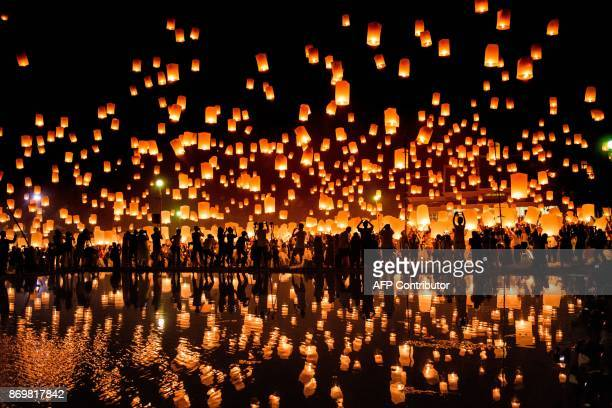 TOPSHOT A crowd releases lanterns into the air as they celebrate the Yee Peng festival also known as the festival of lights in Chiang Mai on November...