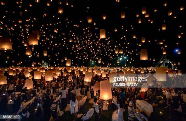 A crowd releases lanterns into the air as they celebrate the Yee Peng festival also known as the festival of lights in Chiang Mai on November 3 2017...