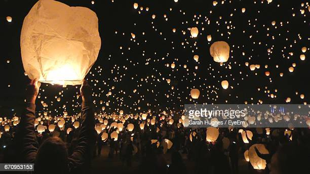 crowd releasing lanterns at festival - releasing stock photos and pictures