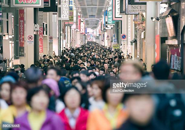 crowd shopping at minami area in osaka, japan - western script stock pictures, royalty-free photos & images