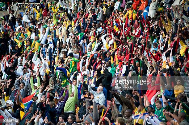 crowd shot at a soccer game, johannesburg, south africa - crowd doing the wave stock pictures, royalty-free photos & images