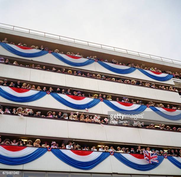 A crowd sings patriotic English songs from the stands at Royal Ascot June 2002