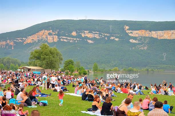 Crowd sitting in grass