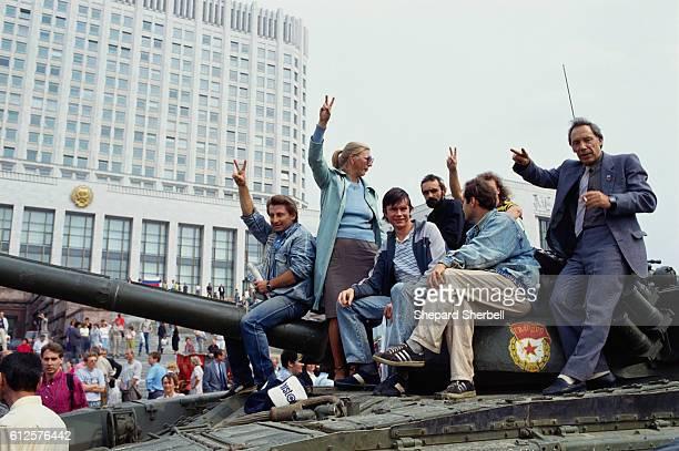 Crowd Sitting on a Soviet Tank