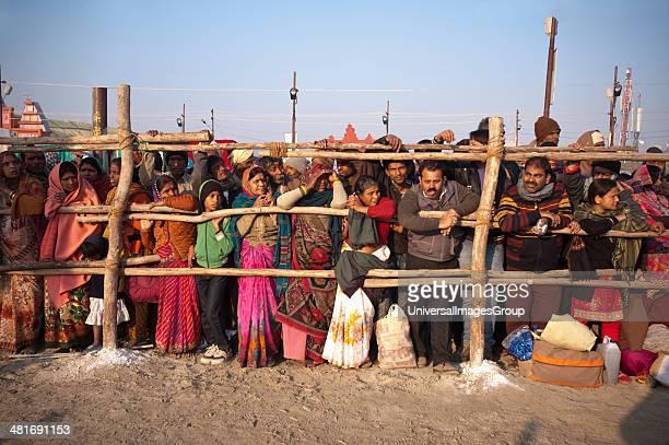 Crowd standing behind a fence at Maha Kumbh Allahabad Uttar Pradesh India