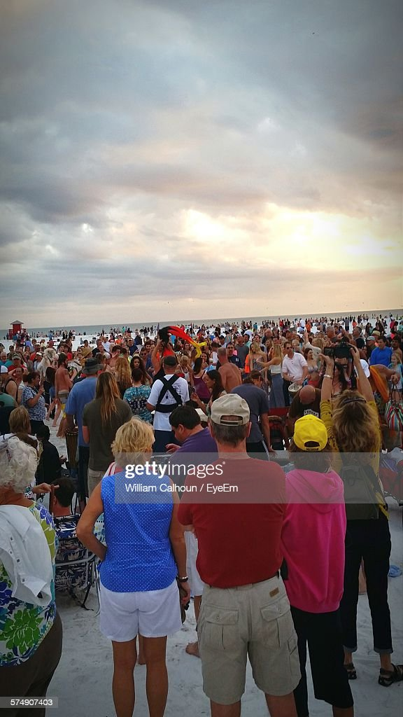 Crowd Standing On Beach During Sunset : Stock Photo