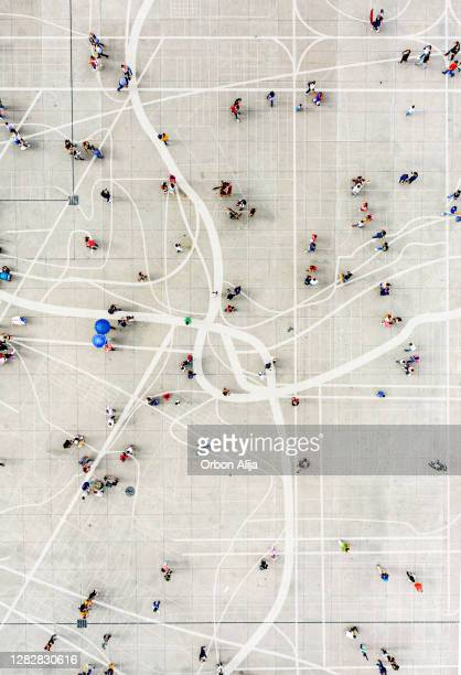 crowd standing on top of city map - citizenship stock pictures, royalty-free photos & images