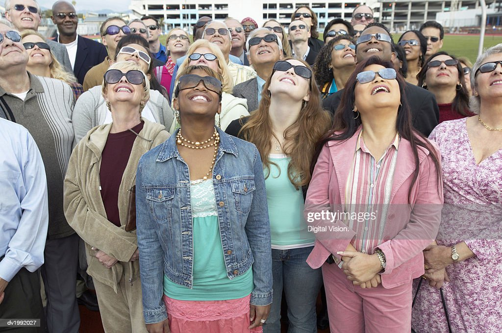 Crowd Standing Wearing Sunglasses Looking Up : Stock Photo