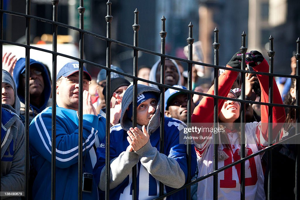 A crowd stands at the gates of City Hall to try and see The New York Giants' Victory ceremony on February 7, 2012 in New York City. The Giants defeated the New England Patriots 21-17 in Super Bowl XLVI on Sunday, February 5, 2012.
