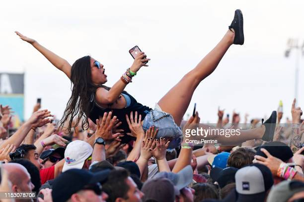 A crowd surfer celebrates Taking Back Sunday's performance during the second and final day of Warped Tour on June 30 2019 in Atlantic City New Jersey