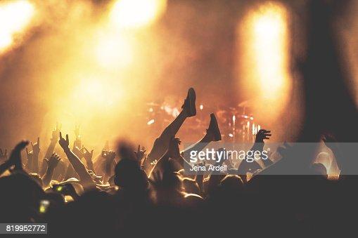 Crowd Surfer Crowd Surfing At Concert Venue