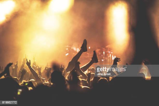 Crowd Surfer Crowd Surfing At Concert Venue